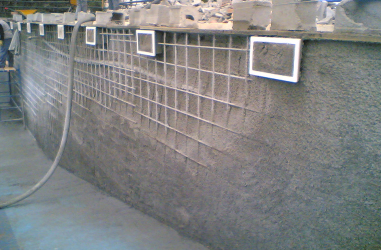 Adaptation of the skimmers and construction of a reinforced wall.